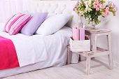 pic of comforter  - Comfortable soft bed in room - JPG
