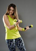 pic of cardio exercise  - Fitness young woman doing cardio aerobic exercises with light dumbbells - JPG