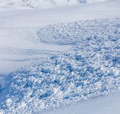 picture of avalanche  - Close up of snow clods on the track of the avalanche in the mountains - JPG