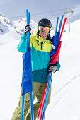 Skier holding poles for slalom