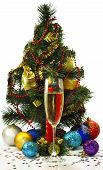 Beautiful Festive Image Of A Glass Of Champagne, Candles And Christmas Tree On A White Background