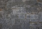 Ancient Stone Wall Made ??of Rectangular Gray Stone