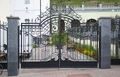 Wrought-iron Gate In Graveyard Beackground