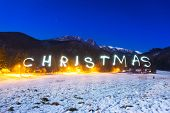 Christmas sign under Tatra mountains at night, Poland