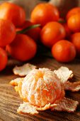 Fresh ripe mandarins on wooden background