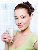 Beautiful Young Woman With Glass Of Water