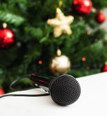 picture of christmas song  - Black microphone on white leather sofa near the Christmas tree - JPG