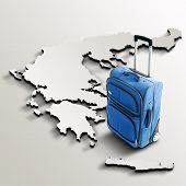 Travel To Greece. Blue Suitcase On 3D Map Of The Country