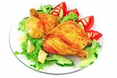 roasted chicken drumstick with vegetables over white