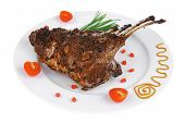 served roast ribs on plate isolated over white