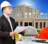 Architect Man And Working Ducument Plan In House Construction Site With Working Table Scen Foregroun
