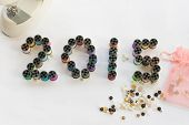 Year 2015 spelled with spools of thread
