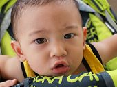 asian baby with doubtful look on his face