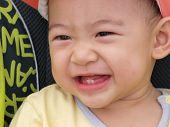 asian baby in sitting stroller