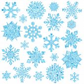 Set Of Light Blue Crystal Snowflakes Isolated On White