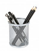 Black pens and pencils in metal vase isolated on white background