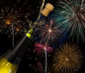 Bottle of champagne and fireworks, celebration concept