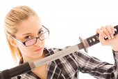 attractive businesswoman in glasses with a katana