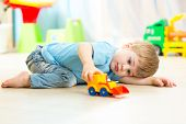 picture of pretty-boy  - child boy toddler playing with toy car indoors - JPG