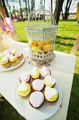 stock photo of wedding feast  - Wedding sweets on the table in the street - JPG