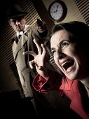 picture of guns  - Detective standing in the dark and pointing a gun to a screaming woman - JPG