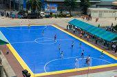 Sportsmen Train On Blue Stadium