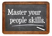 Master your people skills - white chalk text on a vintage slate blackboard