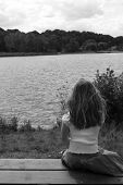 young girl contemplating the lake
