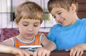 image of screen-porch  - Happy kids playing with a smart phone - JPG