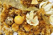Christmas Balls And Stars Decorate On A Gold Background As New Year Or Christmas Concept.