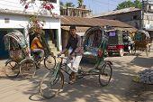 Rickshaws drive by the street in Bandarban, Bangladesh.