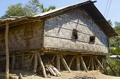 Women look from the windows of their house, Bandarban, Bangladesh.