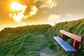 Bench On A Cliff Edge With Sunset
