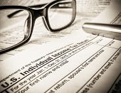 foto of treasury  - Detail Of A 2015 Tax Return Form With Glasses And Pen - JPG