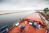 Deck of cargo ship moored in a harbor