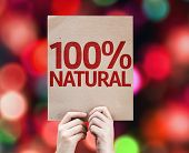100% Natural card with colorful background with defocused lights
