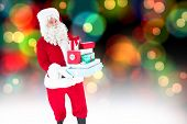 Father christmas holding many gifts against colourful glowing dots on black