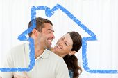 Lovely couple laughing together in the living room against house outline