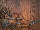 image of work bench  - vintage jeweler tools over wooden working bench space for text