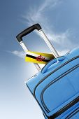 Destination Brunei. Blue Suitcase With Flag.