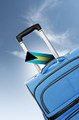 Destination Bahamas. Blue Suitcase With Flag.