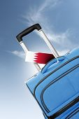 Destination Bahrain. Blue Suitcase With Flag.