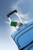 Destination Algeria. Blue Suitcase With Flag.