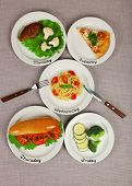 Daily menu. Plates with food on table