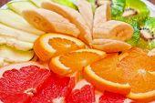 Slices of various fruits closeup photo