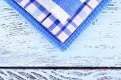 Blue napkins on wooden table