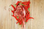 fresh spare ribs : raw lamb with red chili pepper on wooden table