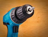 picture of drill bit  - electric drill with drill bit on a wooden background - JPG