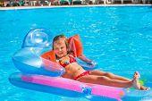 picture of mattress  - Little girl swimming on inflatable beach mattress - JPG