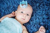stock photo of blue angels  - Portrait of a cute newborn boy with a blue crown  - JPG